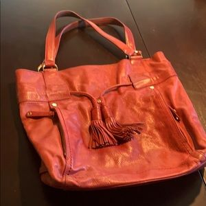 Red Cole Hahn purse with lots of storage.